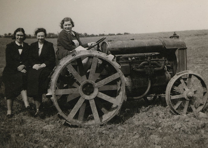 Land Girls sitting on a tractor